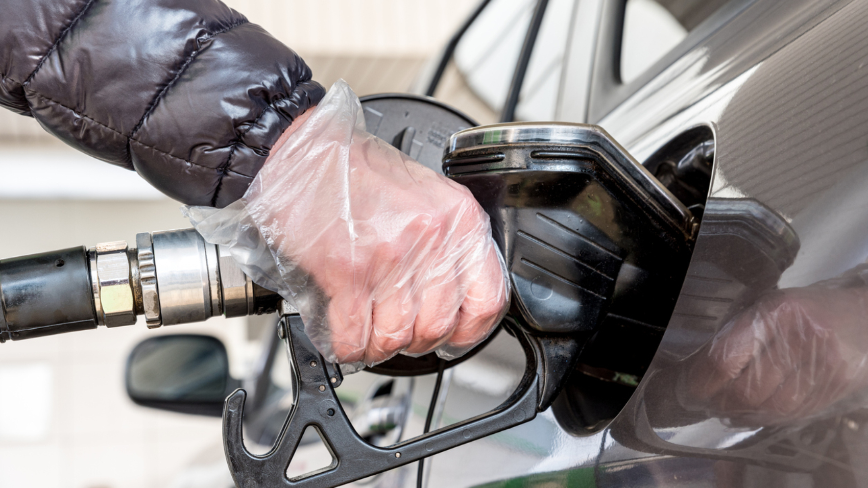 Close Up Woman Hand Refueling the Car in Filling Station