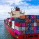 Container cargo ship carrying container for business freight import and export, Aerial view container ship arriving in commercial port.